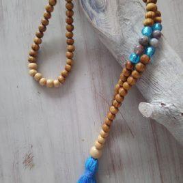 mala-azul- masera -cristal-piedras
